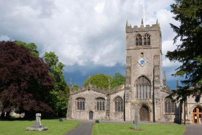 Kendal Parish Church has five aisles and dates from the early 13th century
